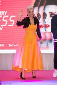 Katy Perry dazzles in bright orange dress at Melbourne's