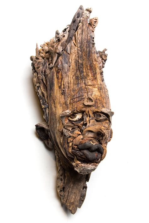 Wall hanging relief faces made from pieces of wood by