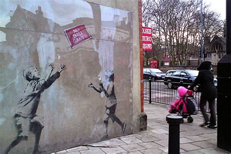 Art attack: second Banksy mural removed from wall for sale